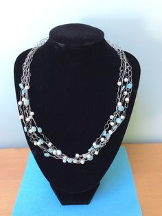 I created this striking necklace by crocheting the wire adding in the pearl effect and light blue beads as I went along. Beaded Necklace, Necklaces, Blue Beads, Crocheting, Light Blue, Wire, Pearls, Create, Jewelry