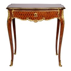 A Louis XV style ormolu mounted and parquetry side table