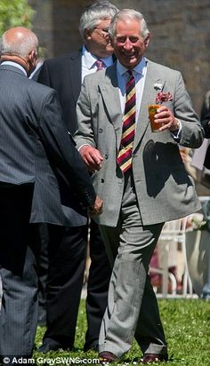 All smiles: Prince Charles beams as he meets locals in the village of Muchelney ~~ 9 July 2014