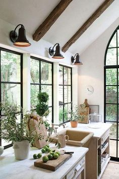 wooden ceiling beams in kitchen. Love the vintage farmhouse lighting