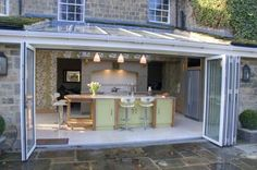 Kitchen with skylight and bi-folding doors