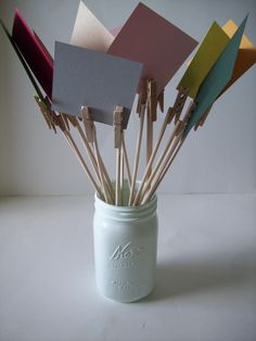 how about this idea? buy mini clothespin, attach them to sticks and put 3-4 pictures of you and jeremy in the center of a mason jar in place of a floral arrangement?