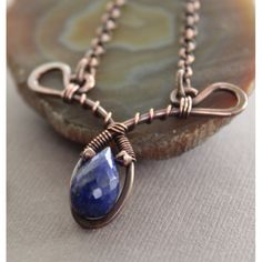 Delicate tear drop wire wrapped pendant