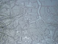 Chris Kabel - Lace Map, 2009  Handcrafted since the 15th century, lace making is one of Belgium's oldest traditions. For this project lace has been used to create a gigantic city map of Bruges, lace capital of Belgium. Streets, alleyways, street names and canals as well as monuments are knitted into a lace pattern onto which tourists can find their way.