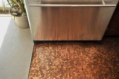 Love the way this penny-tiled floor reflects in the stainless appliances