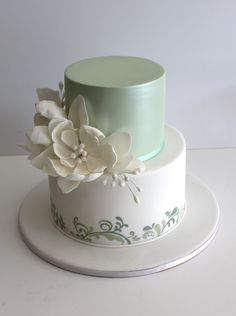 "Faye Cahill Cake Design ""soft greens"". This would be lovely for a small, intimate wedding and you could match the cake colour to the bridesmaids dresses."