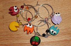 Pac-Man updated to drinking age! These handmade Pac-Man Wine Charms use characters from the vintage arcade game to make markers for wine glass stems, which is Man Character, Love Charms, Baby Cartoon, Baby Socks, Geek Chic, Handmade Silver, Pac Man, Geek Stuff, Charmed