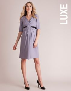 Feel luxurious in our Crepe Drape Maternity Dress; made in a beautifully textured silver violet fabric. The style features a flattering crossover v neckline, which gives way to a beautifully draped panel at the front. A detachable black silk sash highlights your empire waist, threading through at the front, and securing in a stylish bow at the back. Pleats are placed through t...