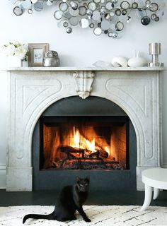 A Chicago Family's Victorian Cottage | Design*Sponge - I love a gorgeous fireplace. It makes for an easy focal point.