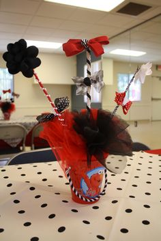 Elmo centerpieces for girl: elmo bucket with bows