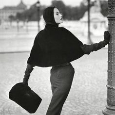 Anne St Marie is wearing a seal skin slip cover cape 1955