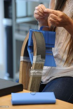 An employee works on a leather wallet at the Maroquinerie de la Tardoire, a Hermes workshop specialized in products made with calfskin, in Montbron, southwestern France, on June 11, 2015.