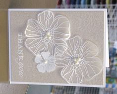 handmade card ... clean and simple .... like these huge flowers embossed on vellum, fussy cut, attched to the card and topped with three pearls in the center ...