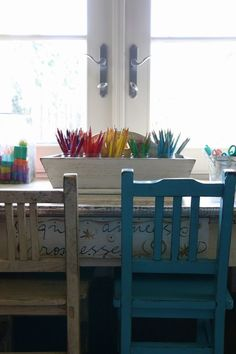 Conner Billingham- Art supplies organized according to color. I like this idea because it gives children the responsibility to put the colors back in the correct spot
