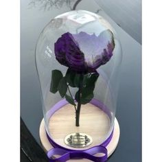 Gorgeous dome with purple eternal  rose . Delivery worldwide! Contact us: contact@buchetino.com .   The rose is eternal and we guarantee that the rose will last for at least 3 years.