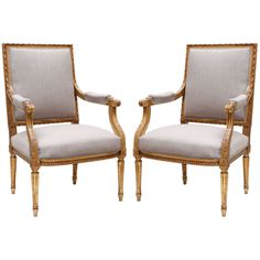 Classic French Louis XVI pair of 23 carat gold leafed armchairs