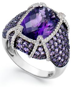 A dead ringer for glam! A cushion-cut amethyst (9 ct. t.w.) takes center stage on this sterling silver ring, while round-cut white topaz (1/2 ct. t.w.) provides extra shine. Sizes 5, 6, 7, 8, 9 and 10