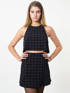 Slim high-waist mini skirt detailed with front darts for a subtle a-line silhouette featuring an all-over contrast grid pattern. A matched piece to The Grid Print Crop - complete the look!
