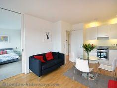Living room Furnished Apartments, West End, One Bedroom, Skyline, King, Flooring, Living Room, Modern, Trendy Tree