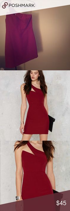 Nasty Gal Asymmetrical Deep Red Mini Dress Unique one shoulder cut out asymmetrical mini dress. Boning through right side so point stays crisp. Not busty enough to fil it out top :( Would fit sizes 8, tight 10 little looser 6. re:named brand never worn purchased from Nasty Gal. Nasty Gal Dresses Mini