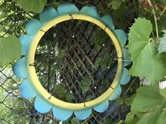 A recycled tire painted and cut to look like a flower