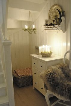 fur cushioning, white, reflective objects and candle light.