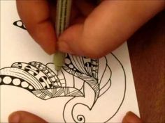 Little bird zentangle.  Love the pattern she uses on the third feather from the top.