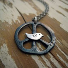a handcrafted organic silver peace sign is blackened and hand etched with whimsical drawings. nested in the middle of the peace sign is a little bird. attached is a sterling silver link chain. Boho Hippie, Hippie Love, Hippie Vibes, Happy Hippie, Hippie Chick, Hippie Style, Bohemian, Jewelry Box, Jewelery