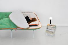 Instead of needing to unfold a pull-out couch, this multifunctional design integrates a comfy place...
