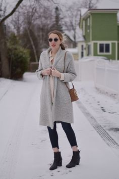 styling a faux suede mini bag with raw edge maternity jeans and an oversized cardigan // Leslie Musser one brass fox