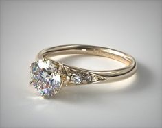 Side Stone Engagement Setting in Yellow Gold - Ring price excludes center diamond.