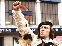 "Citizen Smith a sitcom starring Robert Lindsay as ""Wolfie"", a young Marxist ""urban guerrilla"" in Tooting, South London, who is attempting to emulate his hero Che Guevara. Wolfie is the self-proclaimed leader of the revolutionary Tooting Popular Front (the TPF, merely a small bunch of his friends), the goals of which are ""Power to the People"" and ""Freedom for Tooting"". In reality, he is an unemployed dreamer and petty criminal whose plans fall through because of laziness and disorganisation"
