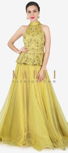 Buy Online from the link below. We ship worldwide (Free Shipping over US$100)  Click Anywhere to Tag Corn green lehenga matched with halter neckline peplum top only on Kalki Corn green lehenga featuring in organza silk.Matched with peplum top in Milano satin with halter neckline.Its embellished in cut dana, zardosi and pearl embroidery. Green Lehenga, Lehenga Skirt, Lehenga Style, Peplum Top Outfits, Peplum Tops, Peplum Blouse, Indian Wedding Outfits, Bridal Outfits, Dress Neck Designs