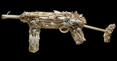 The bone  model MP40 machine gun is 83cm long and its wooden interior frame has been completely  covered with animal bones including rabbits, swan, hedgehog,barracuda,broad-billed prion,petrel, harrier hawk, possum,cat,sheep, black-backed gull, shear-water and the extinct moa. See more at www.mahalski.org.