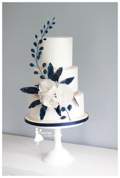 Blue waterpaper feathers and white peonies by Taartjes van An (Anneke) - http://cakesdecor.com/cakes/281982-blue-waterpaper-feathers-and-white-peonies