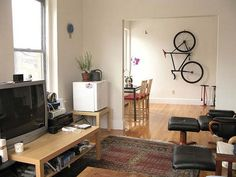 Indoor Bike Storage, Modern Interior Decorating with a Bike Bike Storage Modern, Vertical Bike Storage, Bicycle Storage Rack, Indoor Bike Storage, Storage Racks, Dining Room Wall Decor, Dining Room Design, Diy Bike, Bike Craft