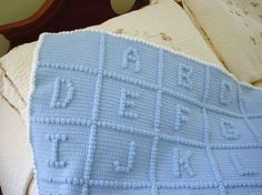 I've made this blanket.  Very pretty but more for display since it's not practical to lay a baby on all of the bumps in the letters.