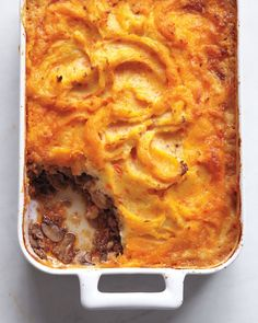 For a different take on meat and potatoes, try this traditional English dish, a savory ground beef mixture topped with mashed potatoes (and, in this version, carrots). -- Cottage Pie with Vegetable Mash Recipe