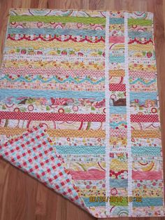 Baby quilt made with a jelly roll.