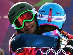 Vic Wild of Russia celebrates winning the gold medal in the Snowboard Men's Parallel Giant Slalom Finals, with Alena Zavarzina of Russia, who won the bronze medal in the Snowboard Ladies' Parallel Giant Slalom Finals. Sochi 2014 Day 13 - Snowboard Men's Parallel Giant Slalom. © 2014 XXII Winter Olympic Games.