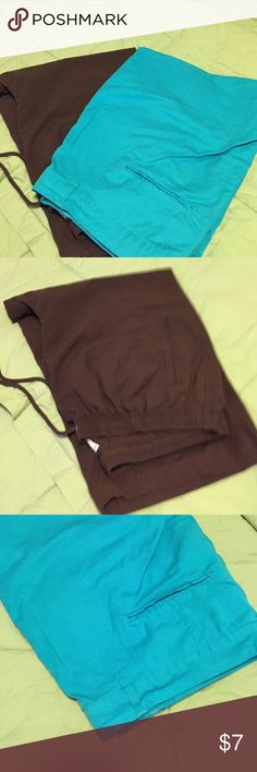 Women's capris one brown and one turquoise 2 pair of woman capris brown pair is from Hastings and Smith, elastic waist 2 little side pockets. Worn 2x. Turquoise pair is from Jessica London cotton/ spandex zippered waist excellent condition Hastings smith/jessica london Pants Capris