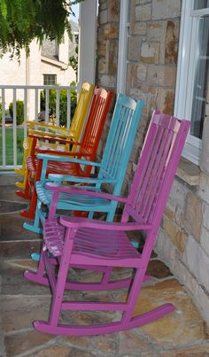 """Repainted my inexpensive white rocking chairs so wouldn't blend in w/railing. Couldn't decide on color so used one of each! Changed front door to a high gloss black, shiny brass door hardware. All """"Fine Paints of Europe"""" in high gloss, COLORS: S2, S5, S18, S23."""