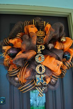 Halloween Wreath, Spider Wreath, Deco Mesh Wreath, Halloween, Spider, Pearl Wreath, Orange Wreath. $115.00, via Etsy.