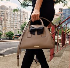 Bows make everything pretty. Will be sporting this Kate Spade leather dome satchel all season.