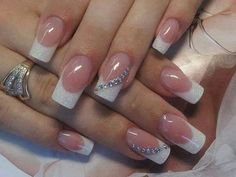 I like this simple pink and white with a hint of bling..... if I get it my nails would be shorter though