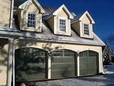 Love this shot of our 3 car carriage house style garage with triple dormers