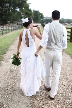 Rustic lace wedding dress with keyhole back. Cute shot of groom holding dress while bride drinks a Coca-Cola! ; Mississippi Wedding