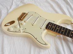 1964 Fender Stratocaster near MINT white gold hardware - http://www.audiotoyshop.com/store/p236/1964_Fender_Stratocaster_Olympic_White_GOLD_hardware___OHSC.html
