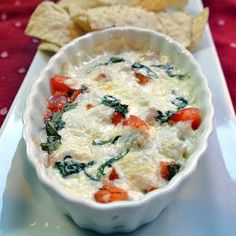 Hot Caprese Dip:  fresh mozzarella  2 roma tomatoes  3 tablespoons freshly chopped basil  3 tablespoons cream cheese  Preheat oven to 375.  Pita Chips would be perfect with this!