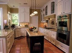 Light cabinets, dark island, light granite.